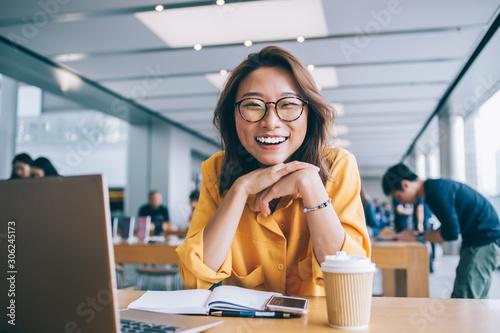 Cheerful female freelancer in workspace