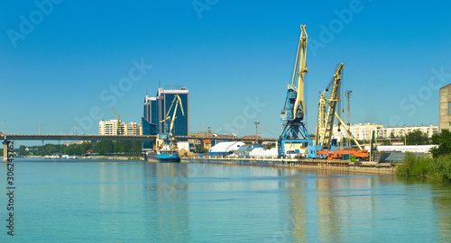View of the bridge and cranes in the port in the city of Astrakhan Canvas Print