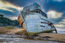 Derelict Shipwreck Under A Dramatic Sky
