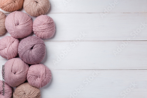 Photo Woolen skeins of thread on white boards