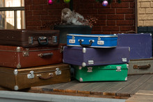Many Suitcases Are Stacked On ...