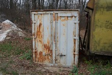 Old Gray Iron Container In Rus...
