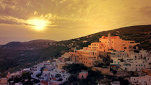 Aerial Drone Photo Of Iconic Uphill Catholic Settlement Of Ano Syra Featuring Church Of Saint George At Sunset With Beautiful Colours, Syros Or Siros Island, Cyclades, Greece