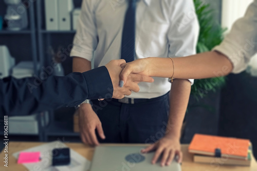 Fototapety, obrazy: In selective focus of  business worker shaking hands together,sign and symbol of success deal and trust,
