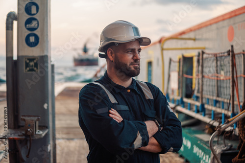 Marine Deck Officer or Chief mate on deck of offshore vessel or ship , wearing P Fototapeta
