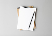 Notebook With Pencil On A Gray...