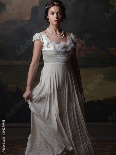 Beautiful young woman in a white long dress in the style of the 19th century Tableau sur Toile