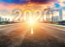 Straight Ahead To The Modern City With The New Year 2020 Concept. The 2020 Number Written In Modern Cities.