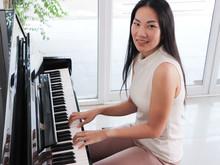 Asian Young Woman Playing Pian...