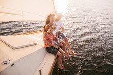 Happy Family Sailing On A Luxu...