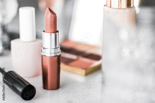 Stampa su Tela Cosmetics, makeup products on dressing vanity table, lipstick, foundation base,