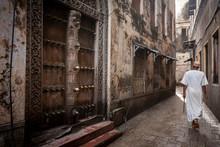 Islamic Man Walking Through Narrow Streets Of Stonetown