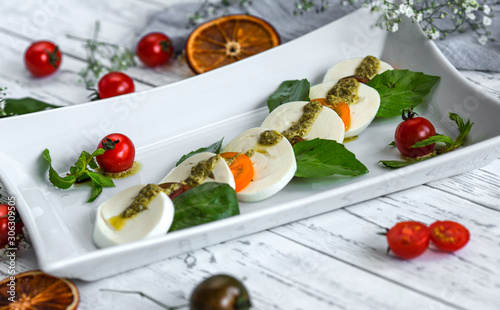 Fotografia, Obraz caprice salad with mozzarella and cherry tomatoes