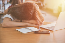 Tired Woman Sleeping On Her Desk