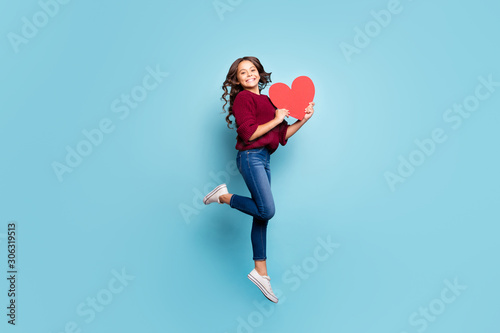 Vászonkép Full length body size side profile photo of schoolgril jumping up holding big re
