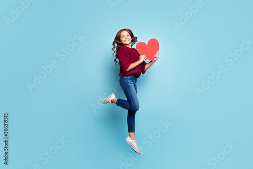 Obraz na plátne Full length body size side profile photo of schoolgril jumping up holding big re
