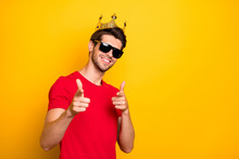 Portrait Of Cheerful Cool Guy Have Gold Diadem Point Index Finger In Camera Choose Best Team Ever Wear Red T-shirt Isolated Over Bright Color Background