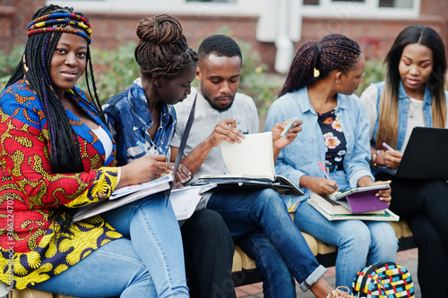 Group of five african college students spending time together on campus at university yard Wallpaper Mural