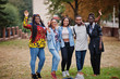 canvas print picture - Row of group five african college students spending time together on campus at university yard. Black afro friends studying. Education theme.