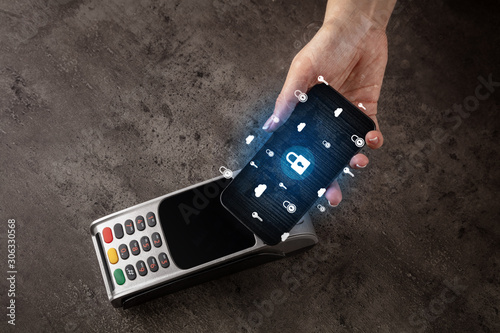 Recess Fitting Asia Country Hand paying with cellphone on POS, secure payment concept
