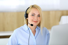 Call Center. Blonde Business Woman Sitting In Headset At Customer Service Office. Concept Of Telesales Business Or Home Office Occupation