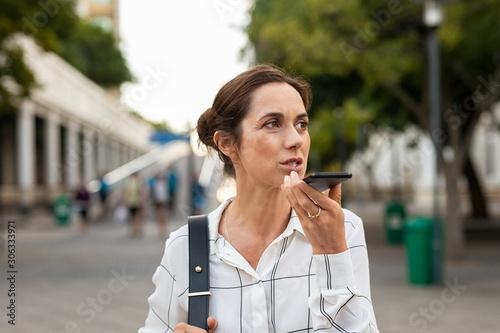 Mature business woman leaving a vocal message