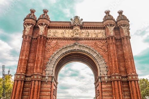 Low angle shot of the ancient historic Arc de Triomf triumphal arc in Catalonia, Wallpaper Mural