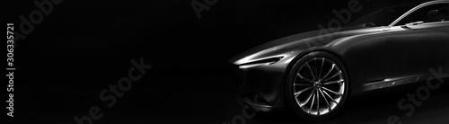 Fototapeta Silhouette of black sports car with one LED headlights on black background,copy space obraz
