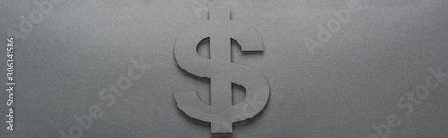 Vászonkép top view of dollar sign on grey background with shadow, panoramic shot