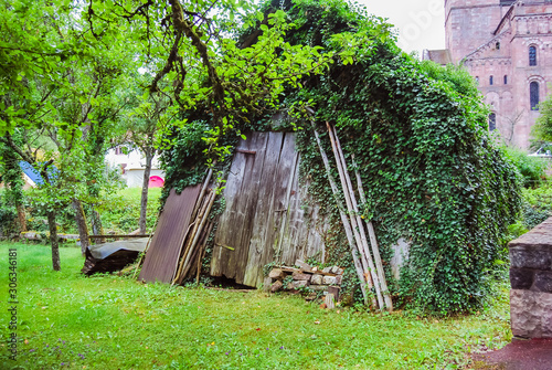Murbach, France - July 21 2012 : Wood hut in front of the Abbey of Murbach, at the bottom of the Vosges valley of Guebwiller, next to Buhl in Alsace Canvas Print