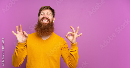 Redhead man with long beard over isolated purple background in zen pose