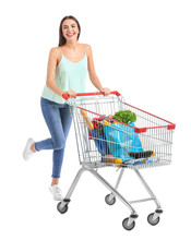 Young Woman With Shopping Cart On White Background