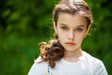Calm Brunette Little Girl In S...