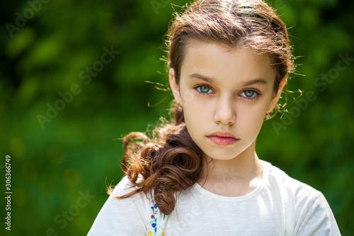 Valokuvatapetti Calm brunette little girl in summer park