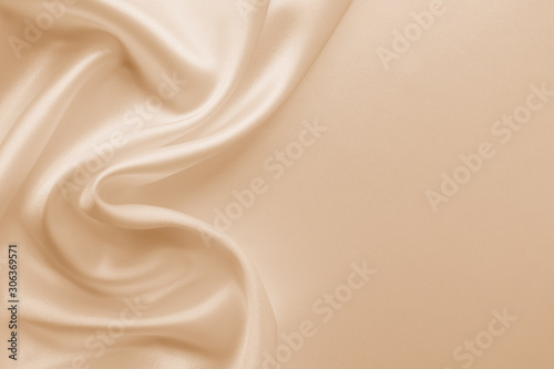 Beautiful smooth elegant wavy beige / light brown satin silk luxury cloth fabric texture, abstract background design Fototapet