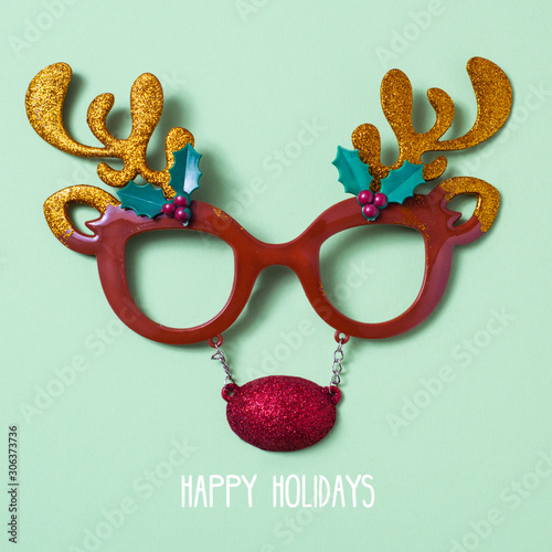 Cuadros en Lienzo reindeer eyeglasses and text happy holidays