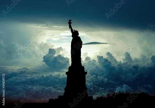 Fototapeta Silhouette of Statue of Liberty over dramatic skies, New York, USA obraz