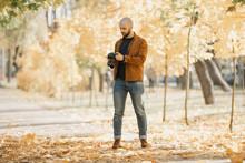 Bald Stylish Photographer With...