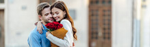Panoramic Shot Of Happy Girl Embracing Boyfriend While Holding Bouquet Of Roses