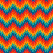 Ethnic Style Seamless Pattern With Chevron Lines. Native Americans Ornamental Background. Tribal Motif. Colorful Mosaic