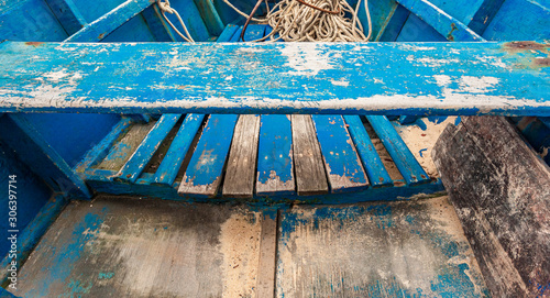 Seat on the inside of an archaic fishing boat. Wallpaper Mural