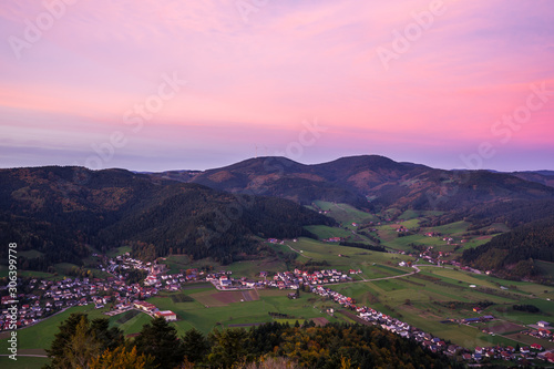 Germany, Red afterglow sky after sunset, aerial view above fischerbach village a Canvas Print