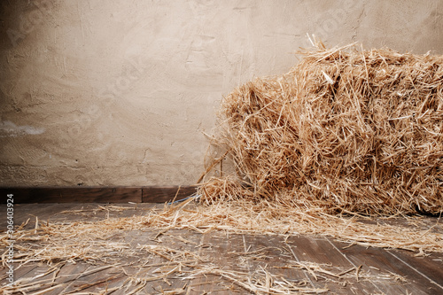 Obraz na plátně Wooden floor background and dry straw