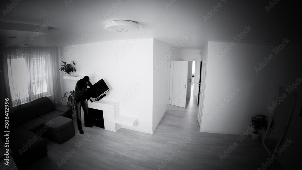 Fototapeta Overhead View Of Thief In Hooded Sweatshirt Stealing From House