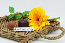 Good Morning Card With Two Creamy Chocolates And Yellow Gerbera Daisy On Wicker Tray