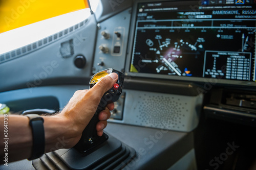 Fotografiet Hand on sidestick control of airplane