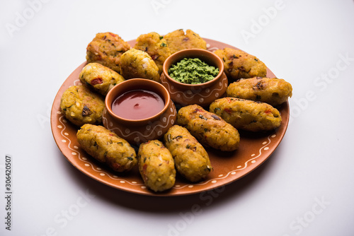 Veg Poha Cutlet or flattened Rice Patties served with tomato ketchup and green c Wallpaper Mural