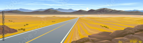 A highway across the hot desert landscape - 306421788