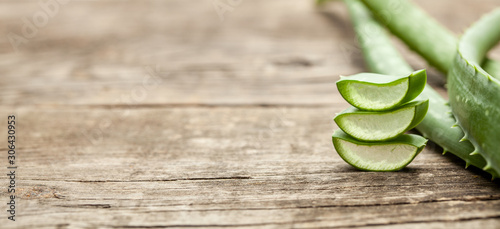 Pieces of aloe vera with pulp on a wooden background Canvas Print