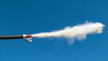 CLOSE UP, DOF: Detailed Shot Of Fire Extinguisher Nozzle Emitting White Powder.